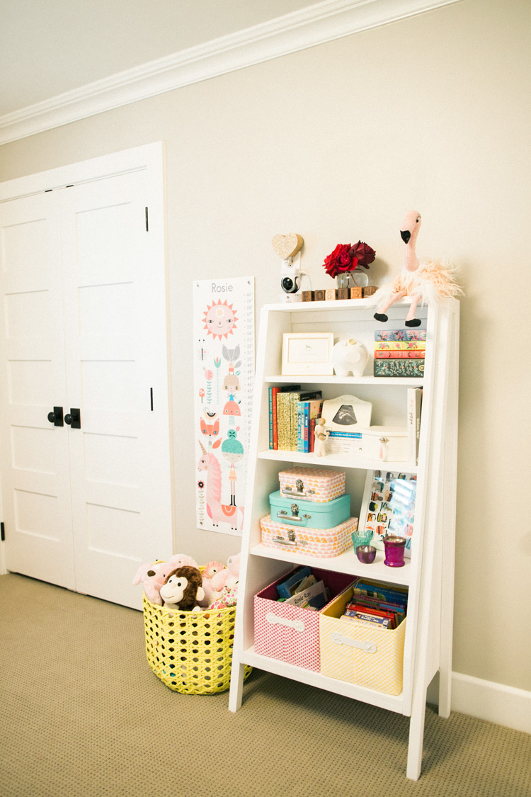 Modern book stand and toys for newborn nursery.