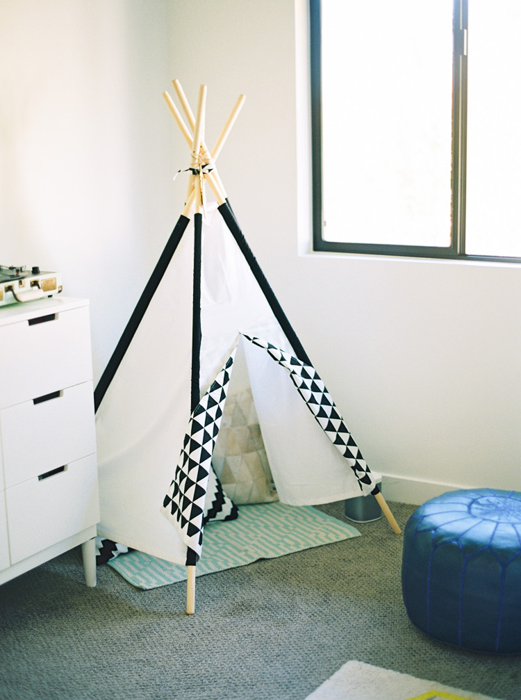 Black & white teepee tent in a modern nursery.