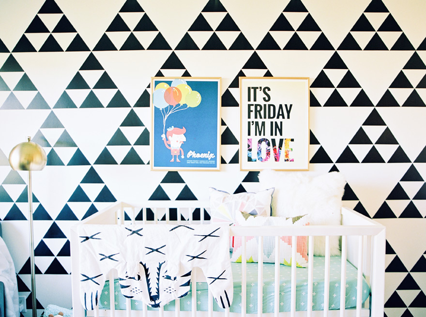 Modern nursery with bold, geometric black & white wallpaper.