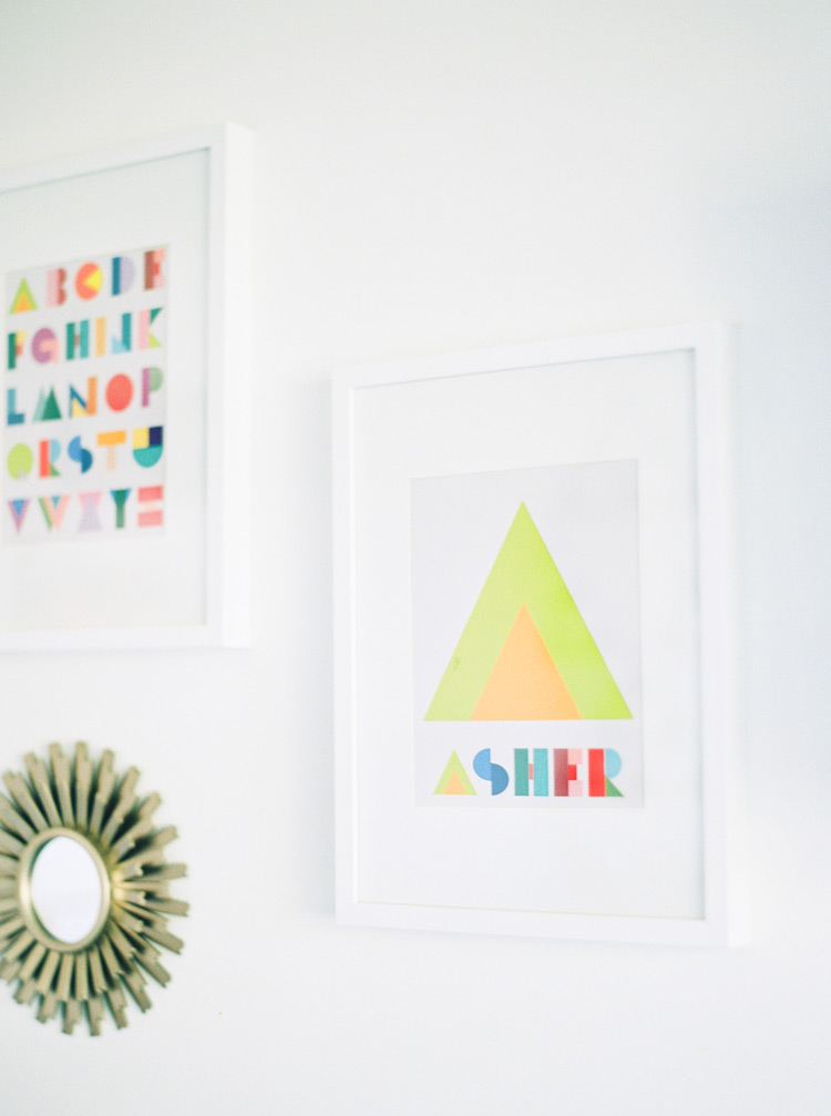 Vibrant art on the walls of a stylish, modern nursery.