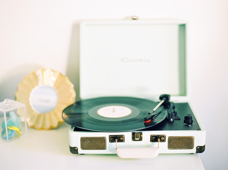 Sweet suitcase record player in a stylish nursery.