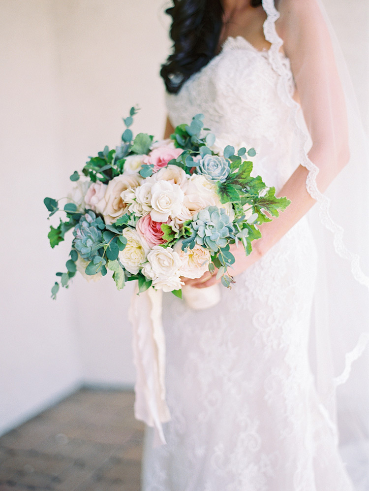 pale, romantic bouquet with succulents