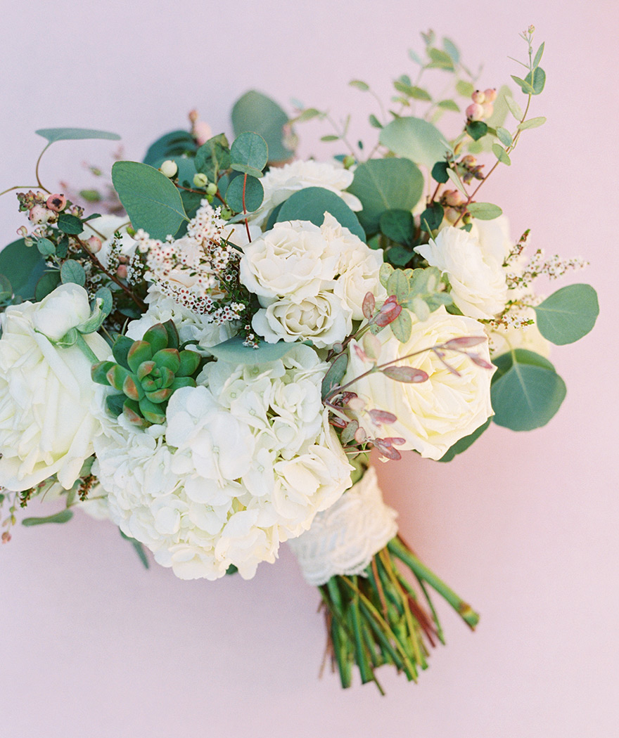 bouquet of white flowers with greenery & succulents