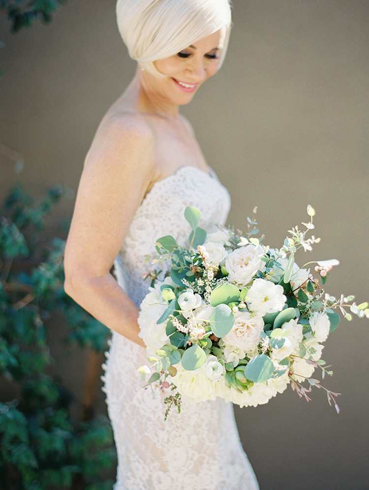 lace wedding dress and a white bouquet