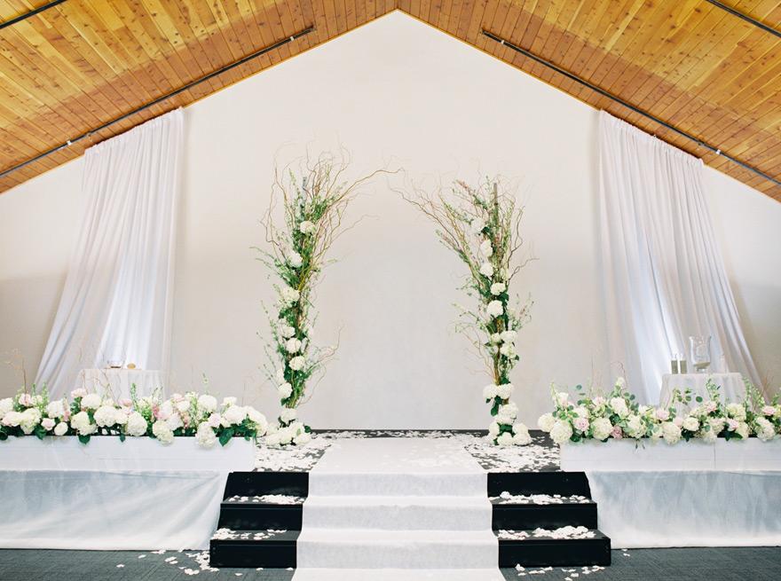 modern florals in a church wedding ceremony