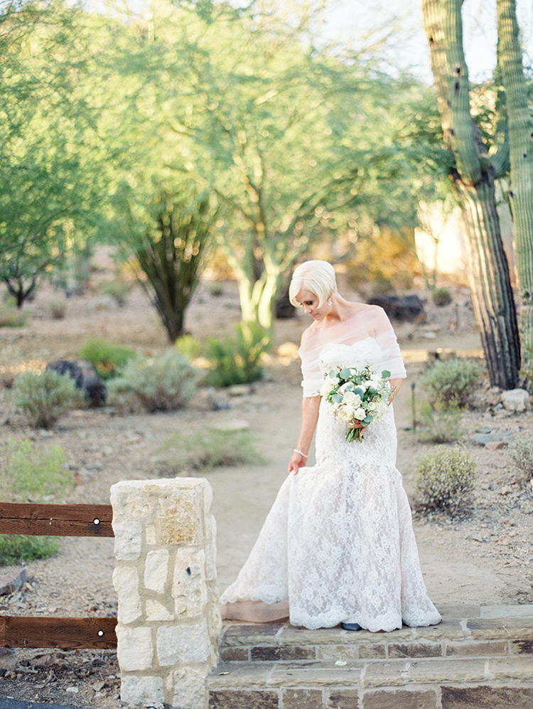 lace wedding gown with tulle wrap