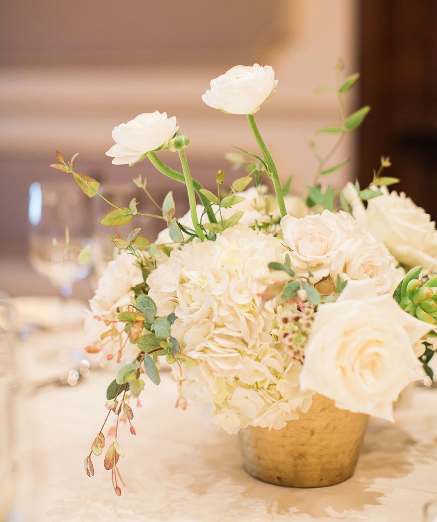 white florals for a ballroom wedding reception