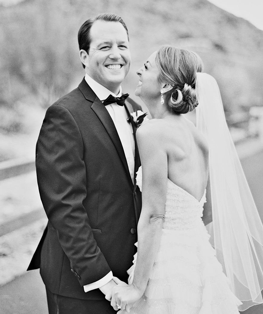 Black and white portrait of a smiling bride & groom!