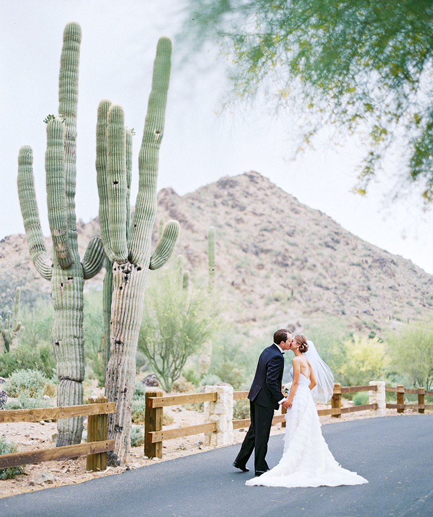 Kissing beside a cactus! Bride & groom spend time before the wedding.