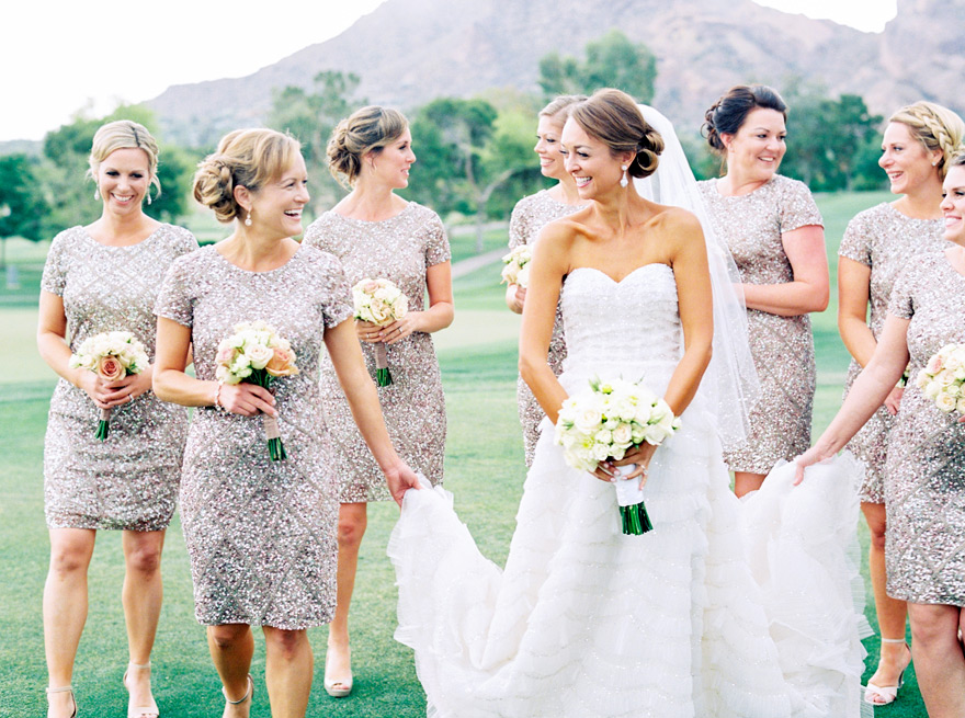 Laughing bride with her bridesmaids. Outdoor wedding, sequined dresses.