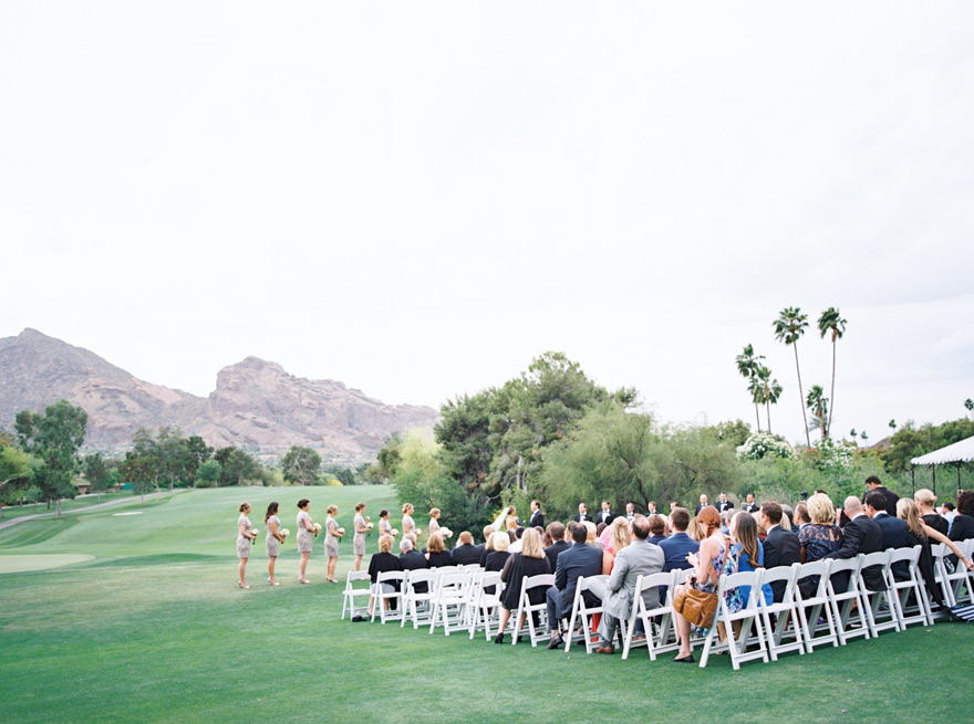 Outdoor wedding ceremony with Arizona mountains in the background.