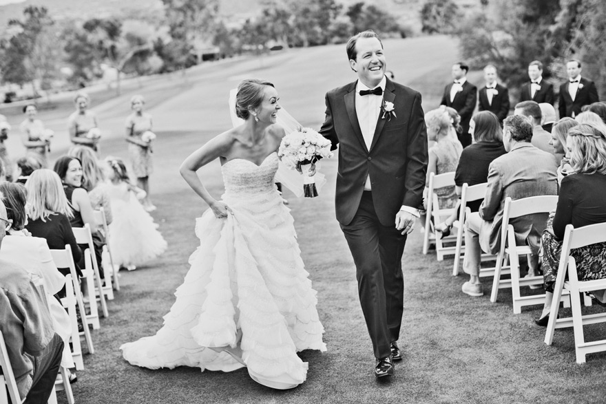 Bride & groom laughing as they walk back down the aisle