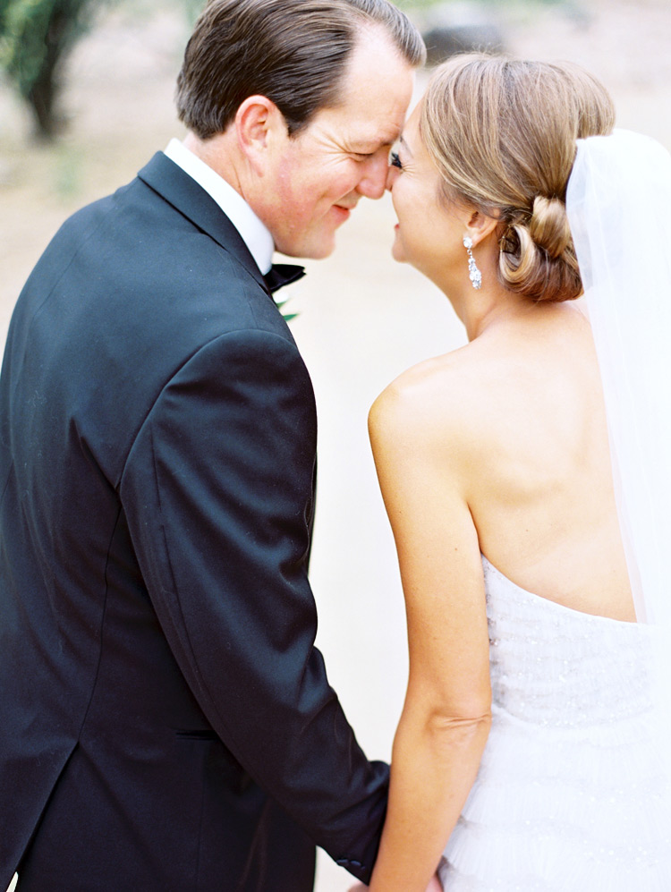 Sweet nuzzle as the bride & groom spend a happy moment together