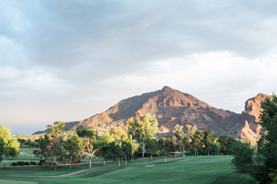 Arizona landscape with smooth green lawns and desert backdrop