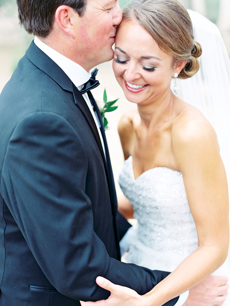 Happy moment before the wedding!  Smiling bride & groom embrace