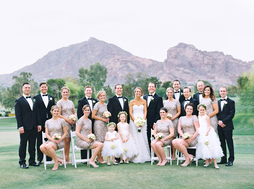 Elegant bridal party in sequined dresses and black tuxes