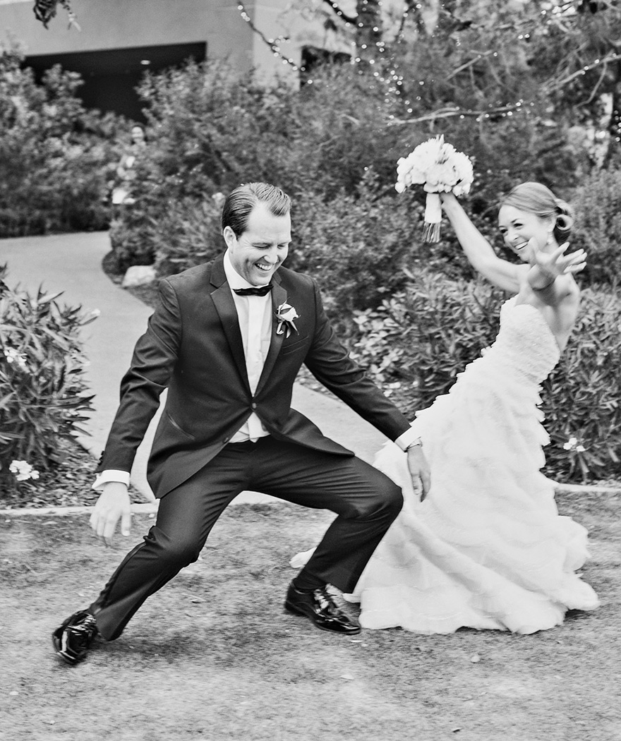 Giddy with happiness, bride & groom dance into their reception
