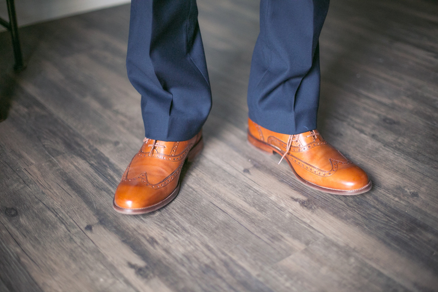 Brown wingtip shoes with a blue suit. Groom ready for his wedding. Dapper groom fashion.