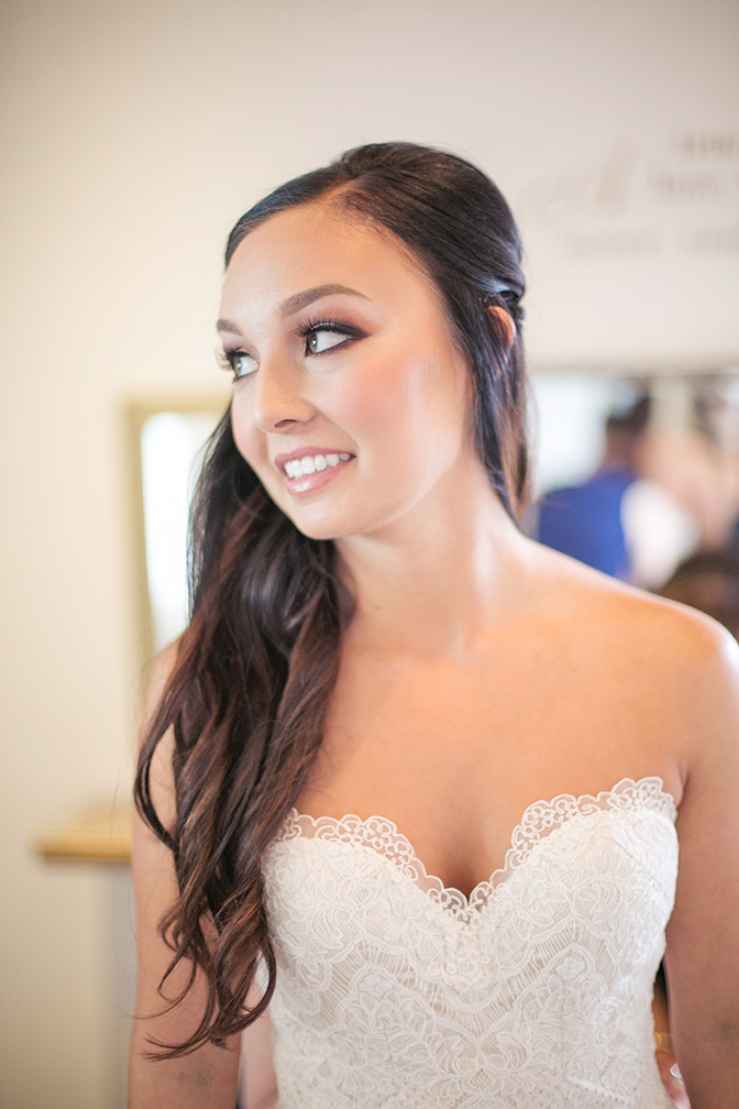 Gorgeous bride with long, dark hair. Strapless lace wedding dress with a sweetheart neckline.