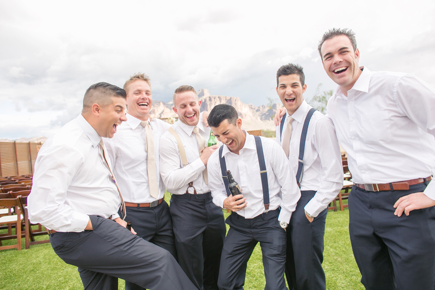 Groom & groomsmen laughing & relaxing before the wedding. Mountain view wedding.