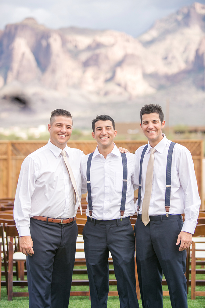 Groom & groomsmen in shirtsleeves and suspenders before the wedding. Arizona mountain view wedding.