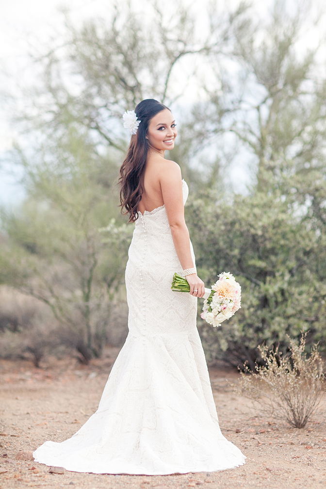 Button back lace wedding dress. Outdoor bridal portrait in the Arizona desert.