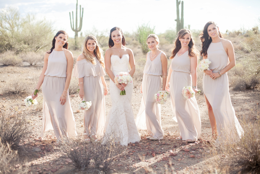 Bridesmaid style -- pale neutral dresses in a variety of silhouettes. Bride in a strapless lace gown