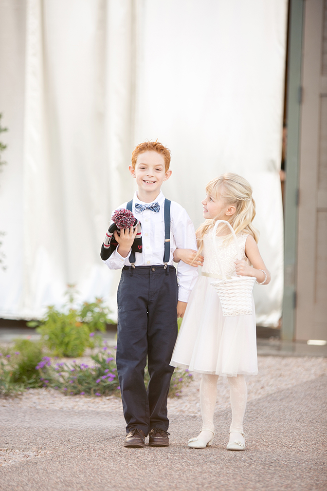 Adorable ring bearer and flower girl ready to walk down the aisle. Unique ring pillow idea.