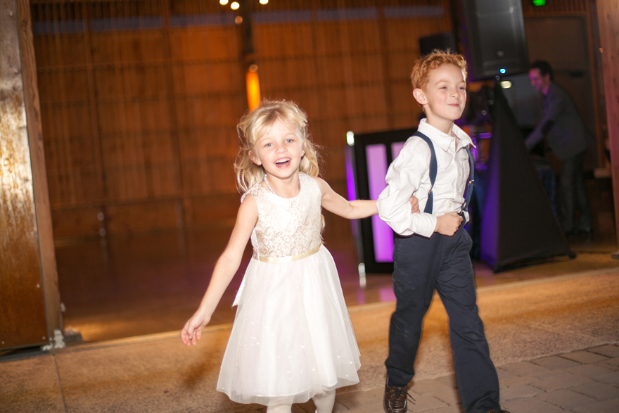 Ring bearer and flower girl make their grand entrance into the wedding reception.