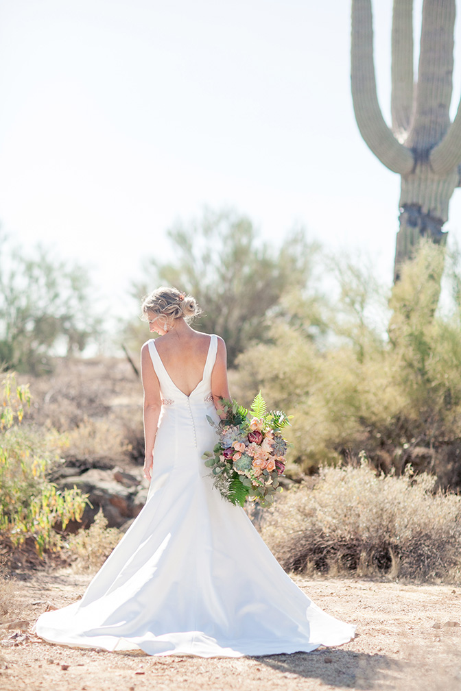 elegant wedding dress and a desert-inspired bouquet