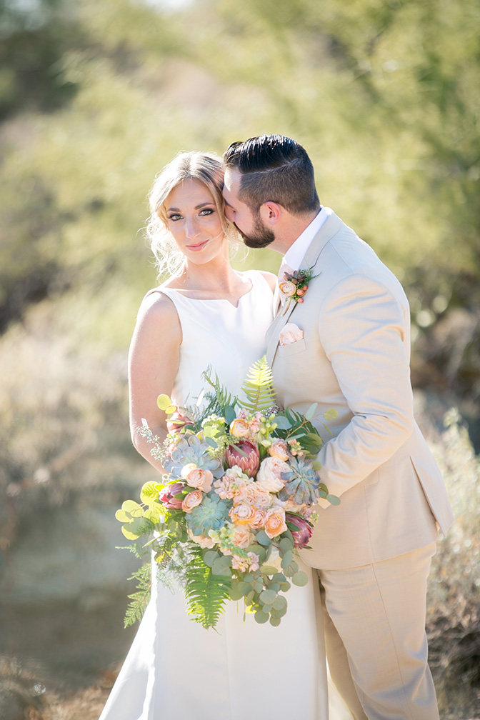 modern, fashionable bride & groom with a desert-inspired bouquet