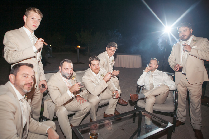 groomsmen enjoy their cigars