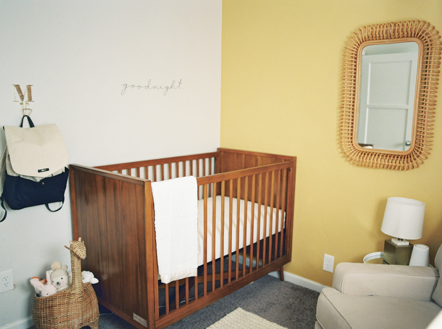 modern nursery with yellow wall