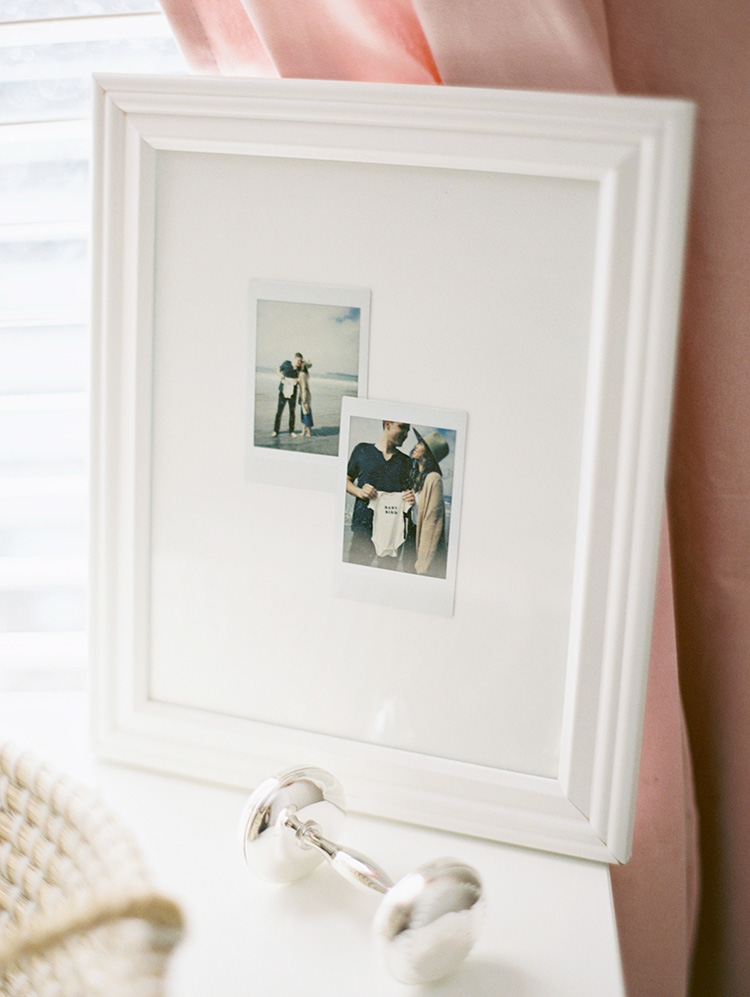 framed photos in a modern nursery