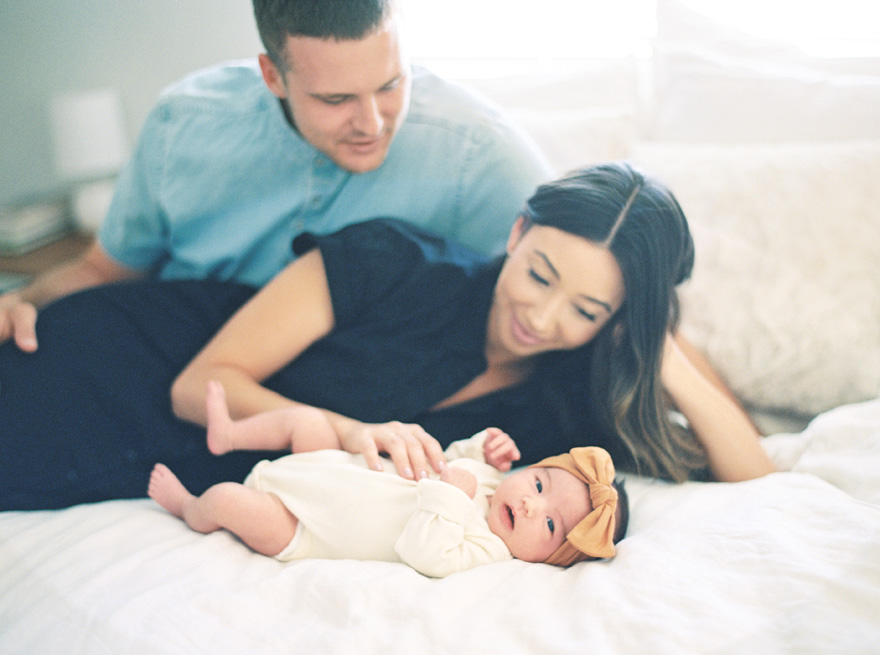 newborn baby girl and her happy parents