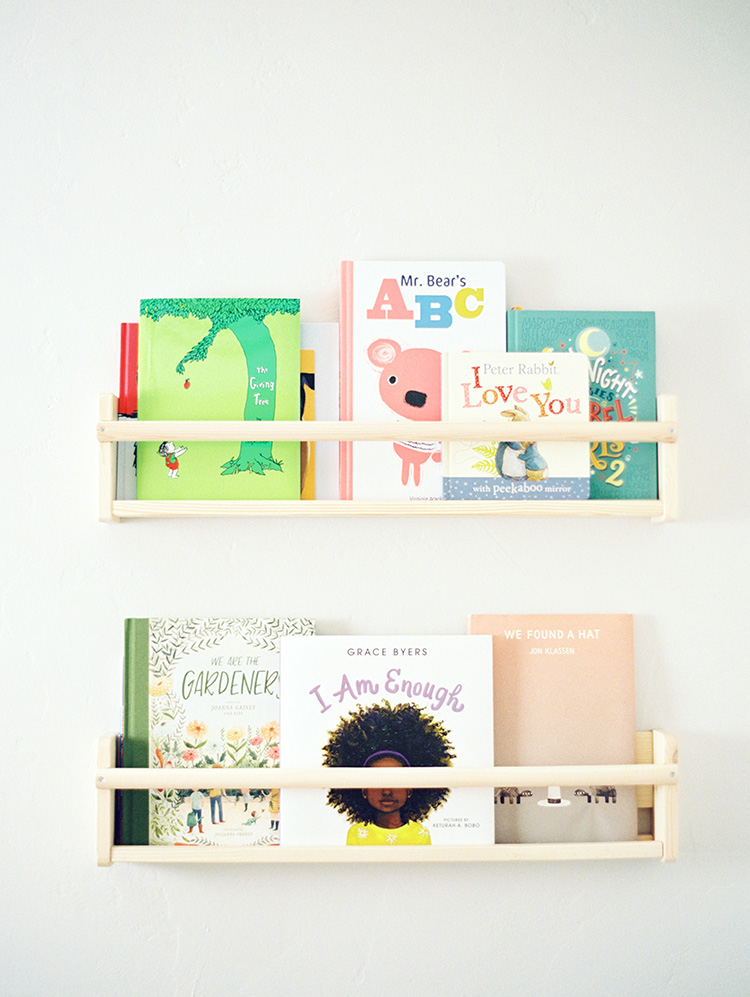 books on display shelves in nursery