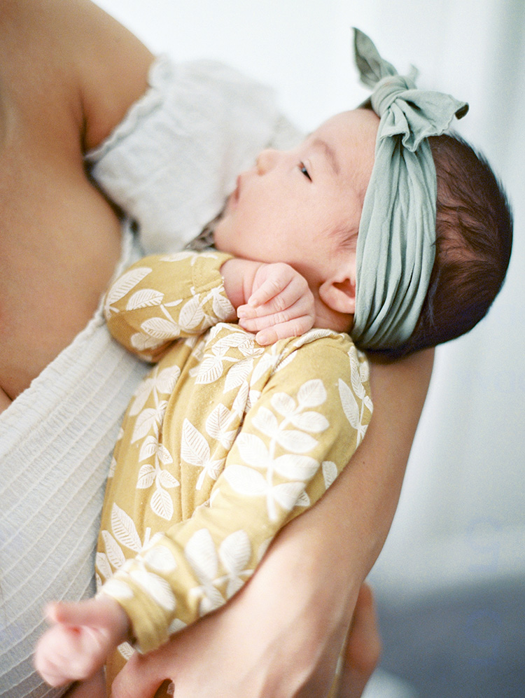 newborn baby girl with headwrap bow