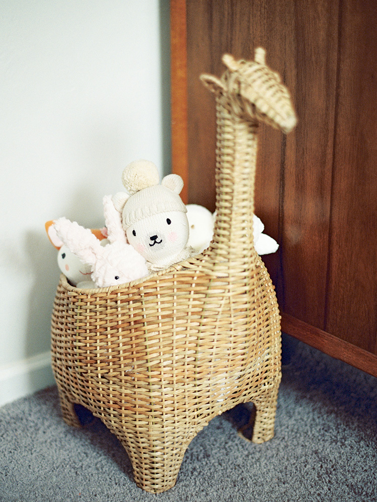 giraffe-shaped toy basket