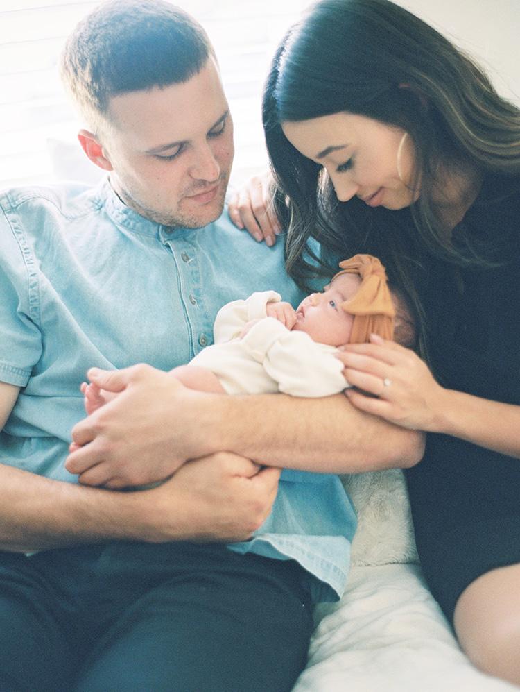 newborn baby girl and her happy parents