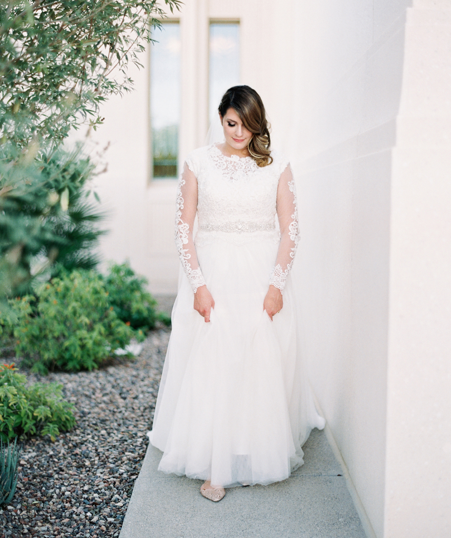 sheer long-sleeved lace wedding dress