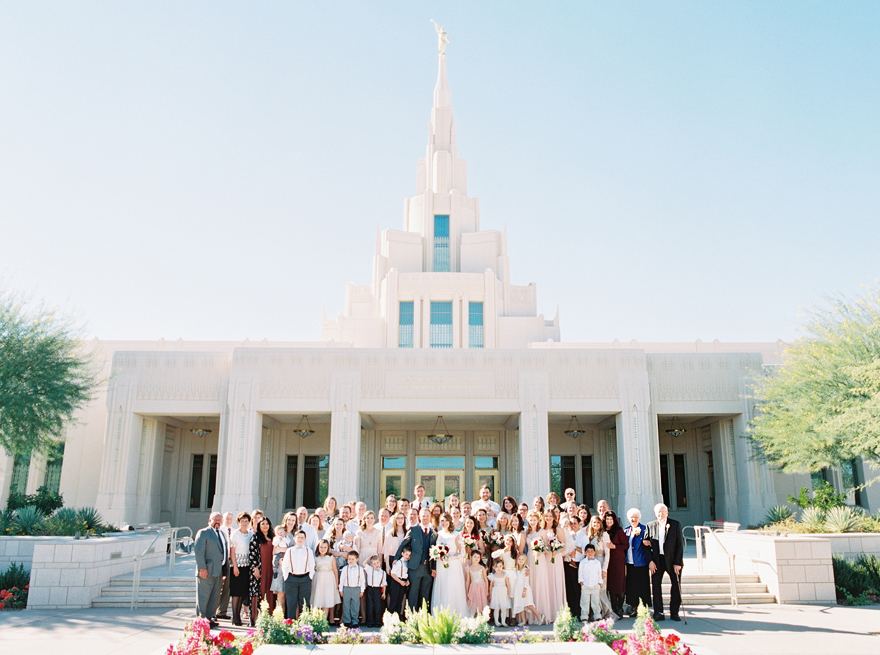 large family portrait in front of the Phoenix LDS temple