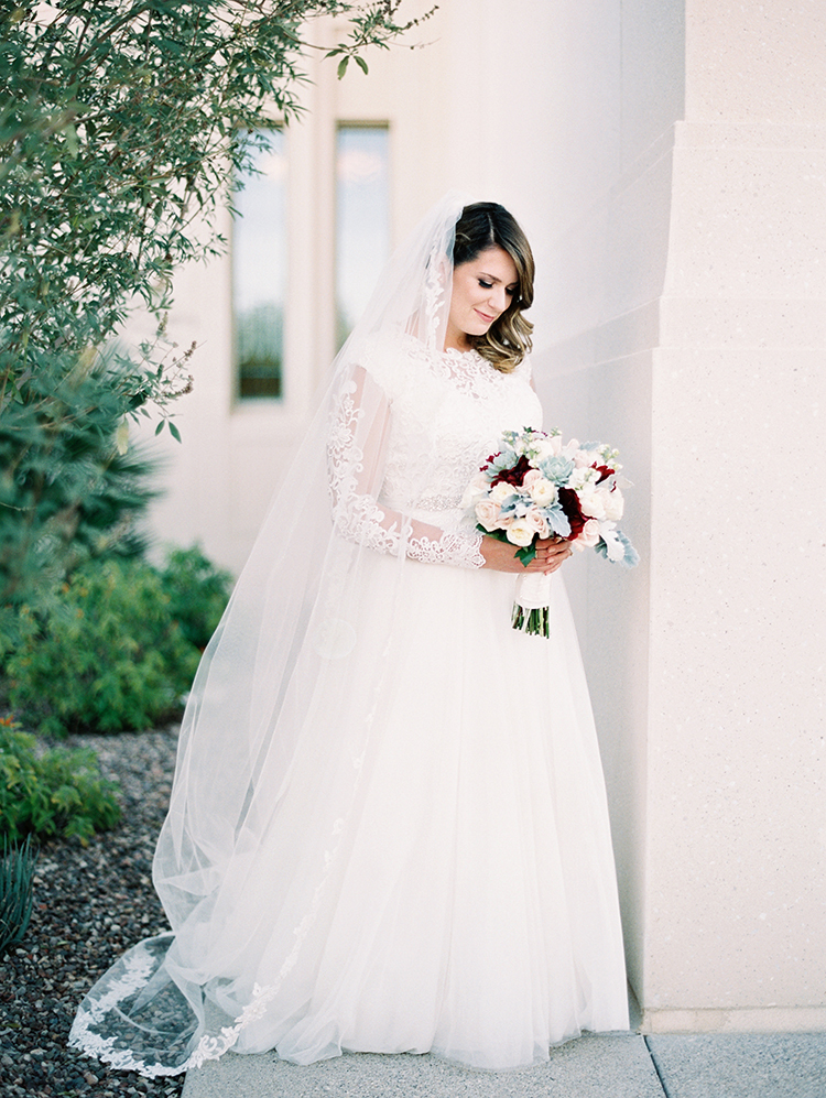 long sleeved wedding dress and veil
