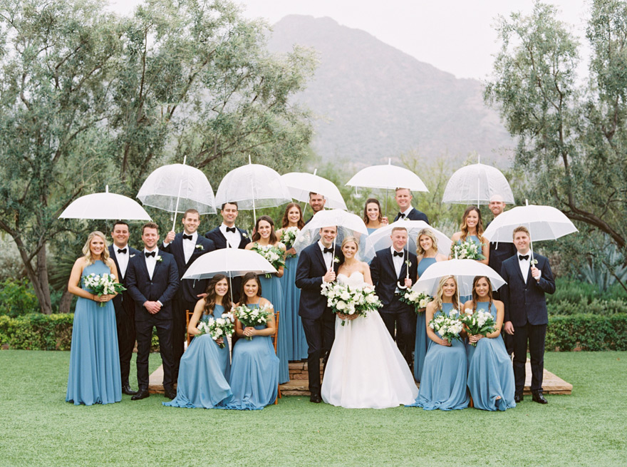 large bridal party with umbrellas at El Chorro