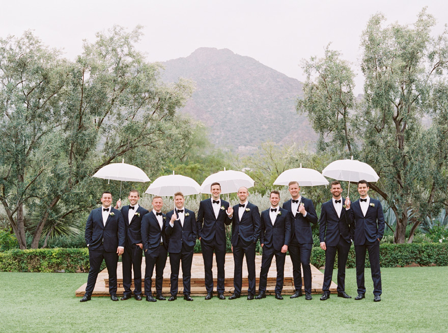 groomsmen with umbrellas at El Chorro