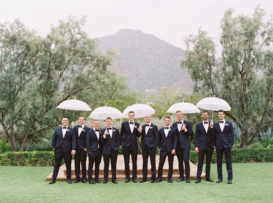 groomsmen with umbrellas at El Chorro
