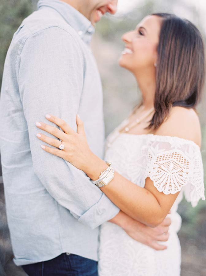 Off-shoulder lace dress and a gorgeous engagement ring