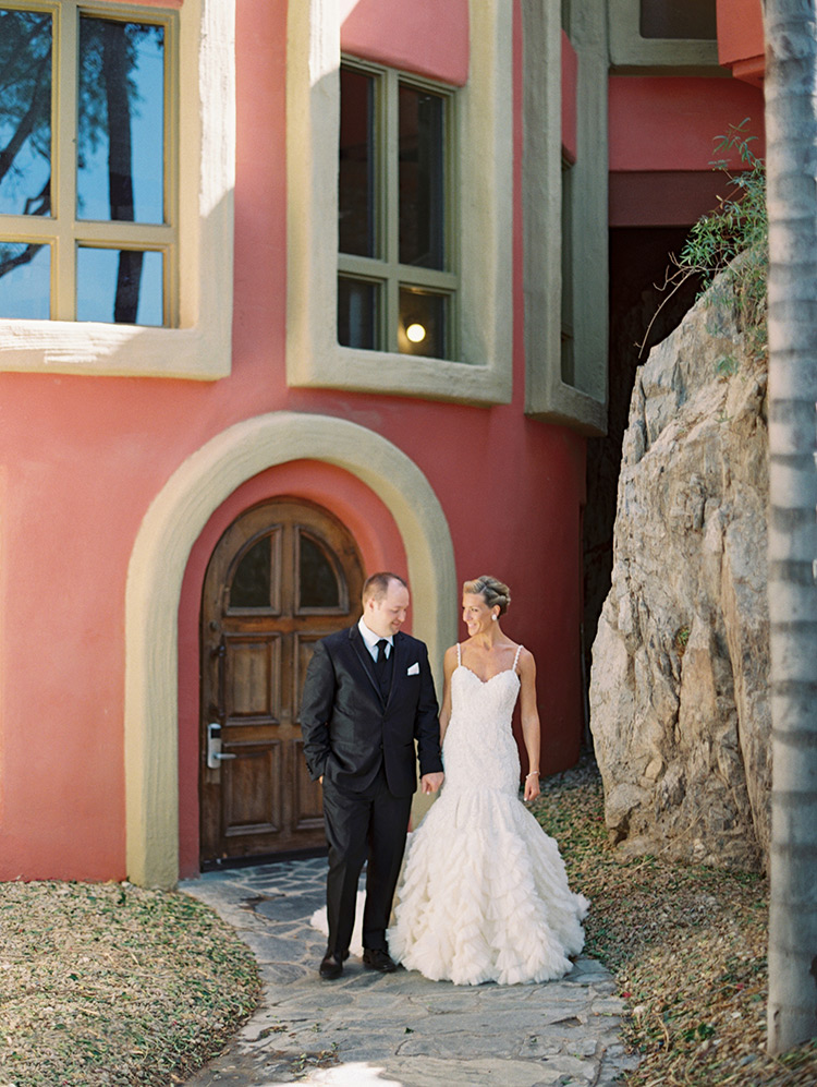 beaded wedding gown from Enaura and a black three-piece suit