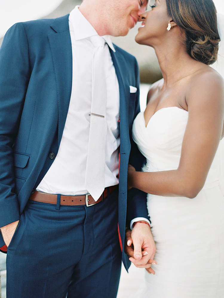 groom in navy and white
