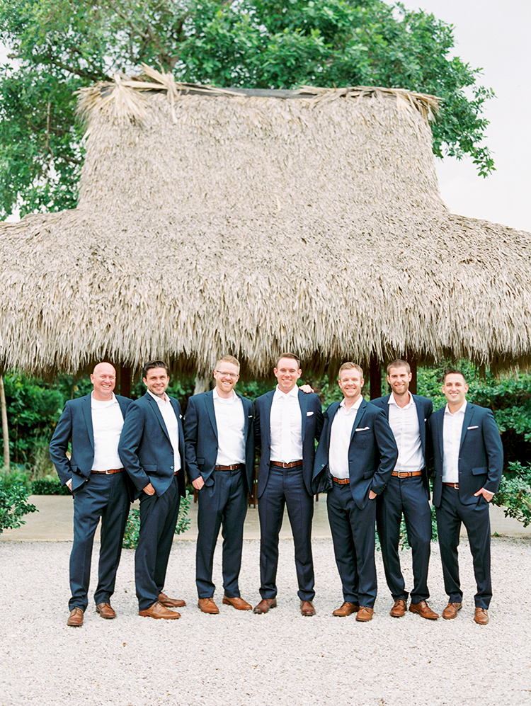 groomsmen in navy for a caribbean wedding