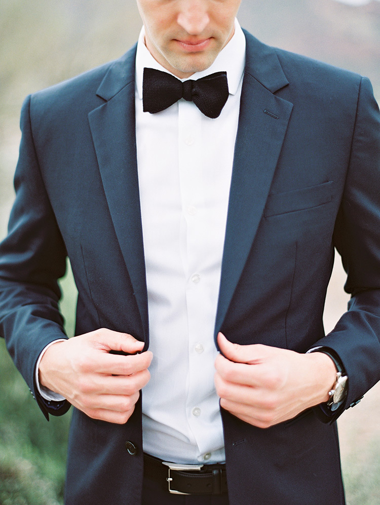 classic black tux and bow tie for the groom